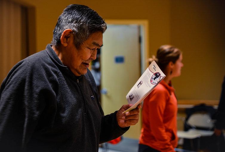 Inuvik Elder reading EIM material (Tony