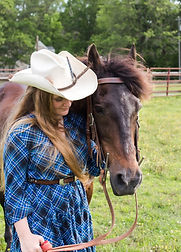 Senior girl from norfolk posing with her favorite horse in chesapeake Virginia
