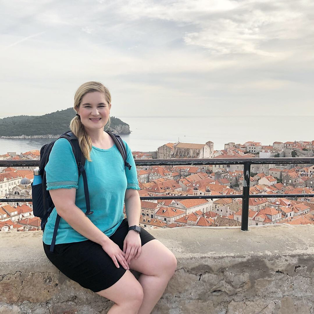 Me sitting on the Dubrovnik City Wall overlooking the Old Town