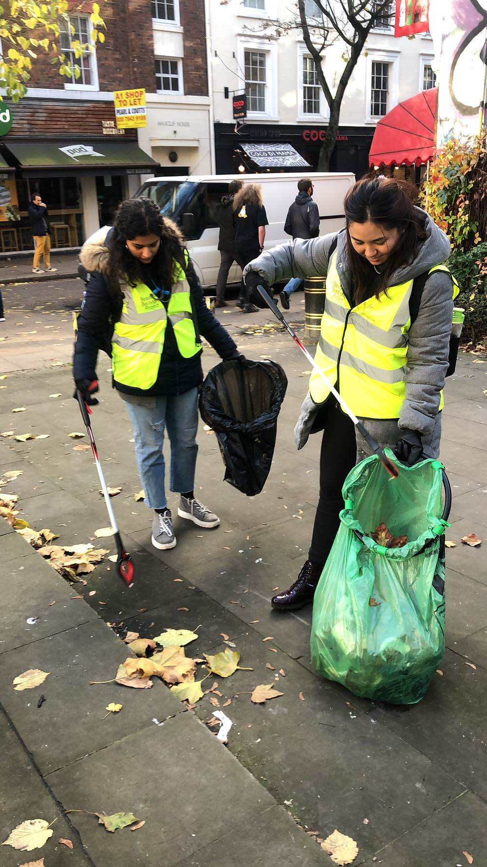 Two consultants from WBC cleaning the streets of London