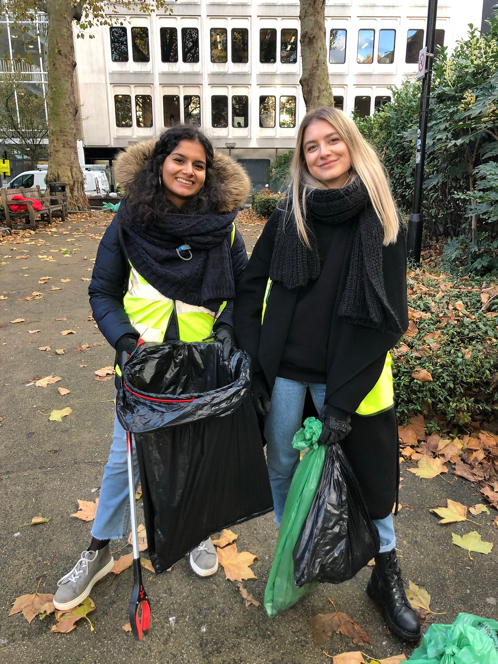 Two consultants after picking up trash for an hour