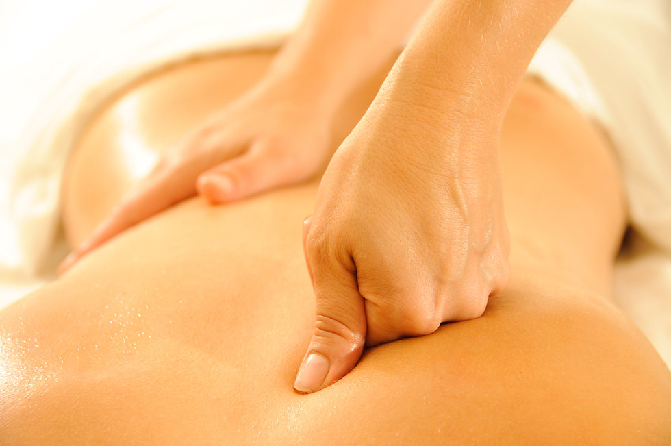 Two white hands massaging client's back. Client is white, only back of torso is seen.