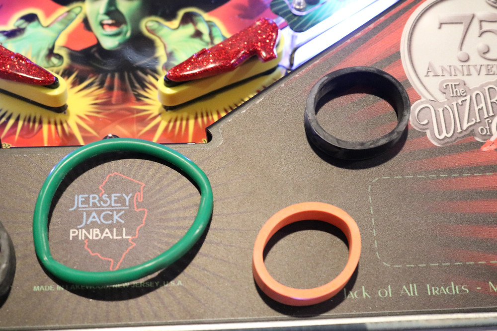 old rings pulled from Wizard of Oz pinball machine. One black. One orange. One green.