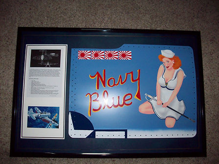 Beautiful, red-headed pinup girl from WWII. Framed standard nose art panel by Dan McQuality.