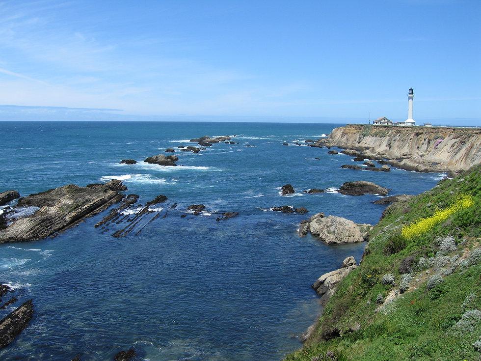 rocky coastline with lighthouse