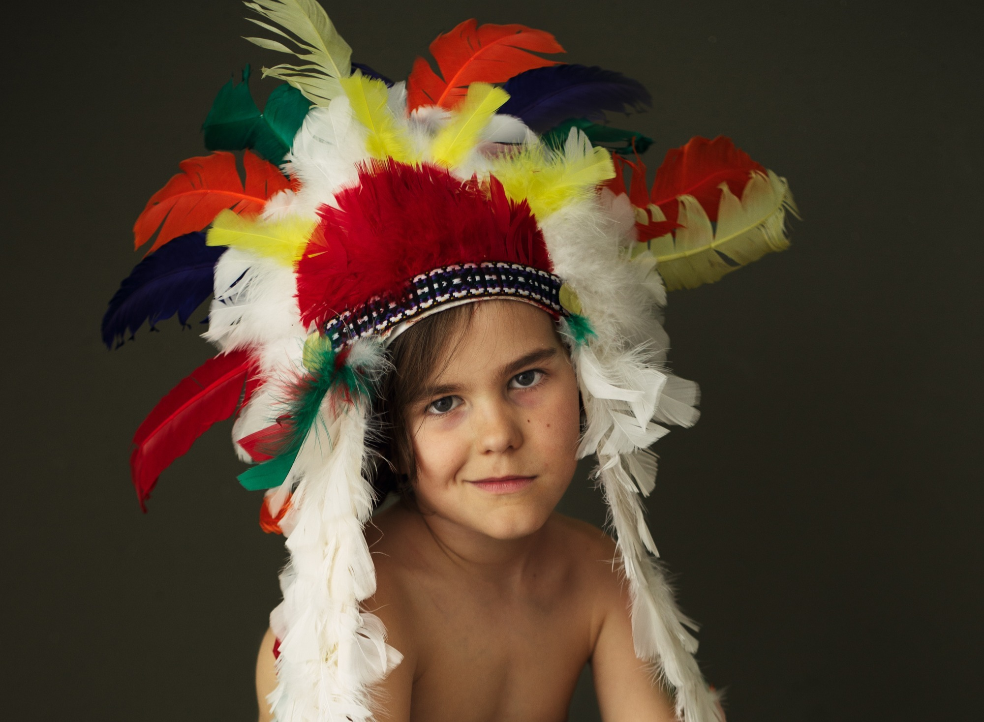 Boy wearing an indian style costume head