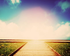 Wooden path leading to crossroads. Direc