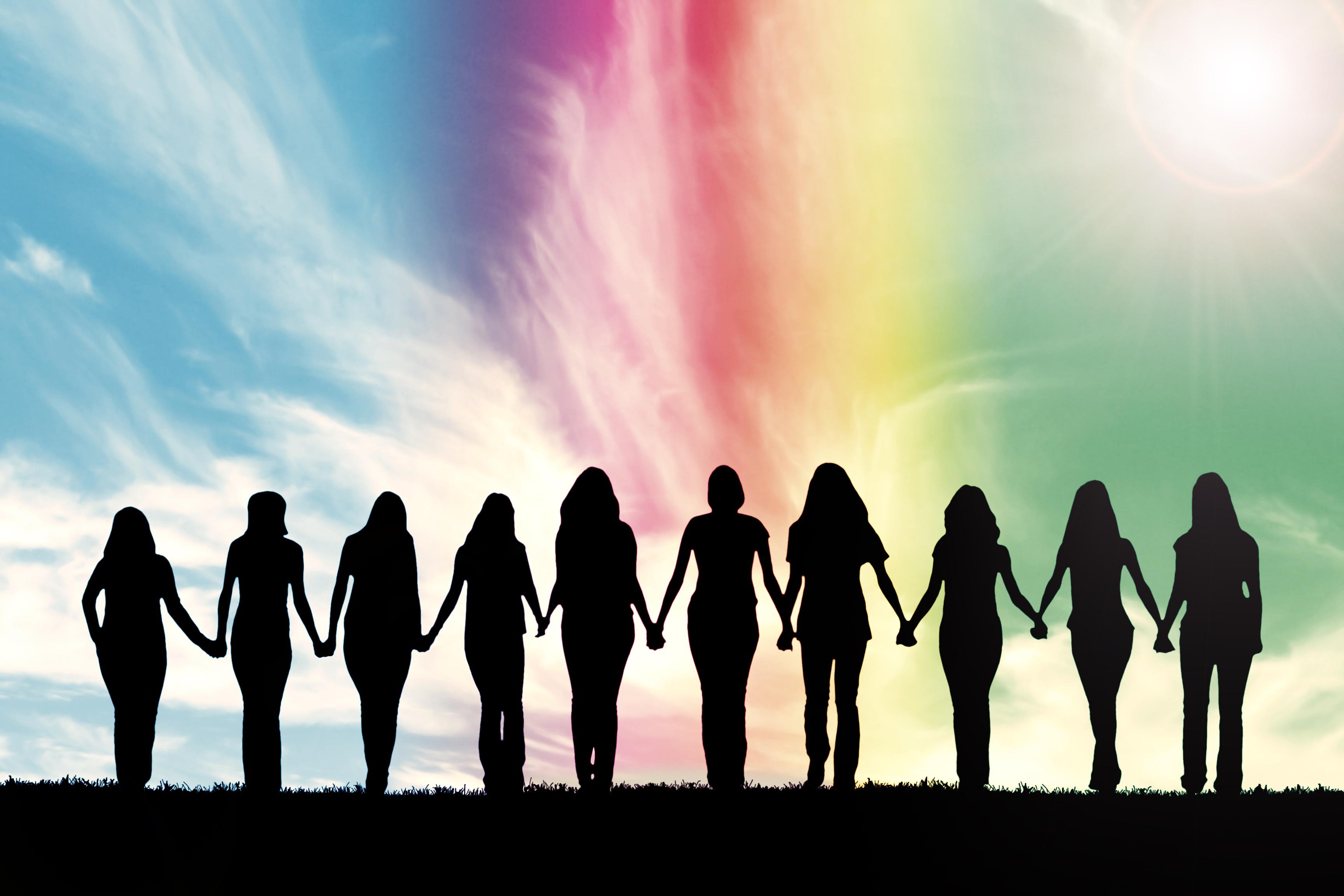 Silhouette of ten young women, walking h