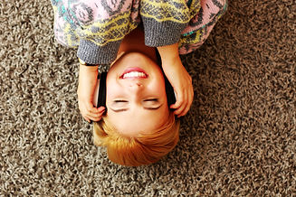 Cheerful young woman listening music in