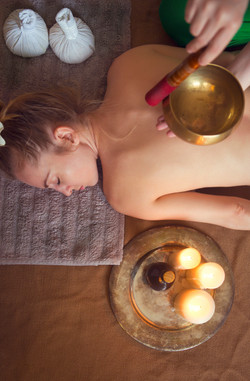 Young woman having massage treatment in