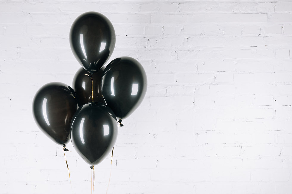 close-up view of shiny black balloons on