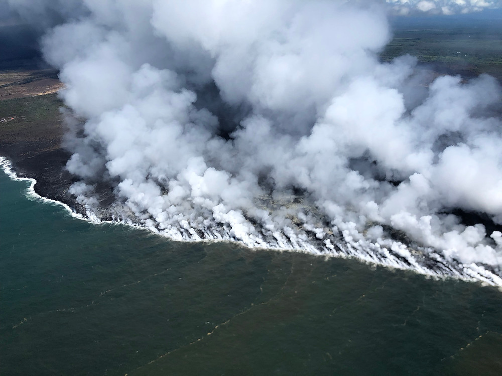 "This image shows the lava steam as lava enters the ocean. AMAZING SIGHT! The ""ocean entry"" at the former Kapoho Bay is over a mile wide."