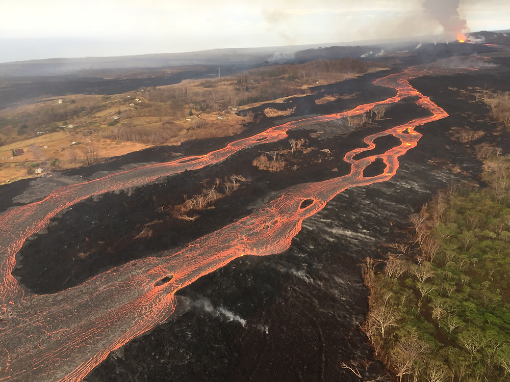 "This photo shows a length of the lava river, with the main erupting vent (Fissure 8) at top right. We didn't see it this ""close up,"" but it was every bit as dramatic, and we could feel the heat! Photo courtesy US Geological Survey"