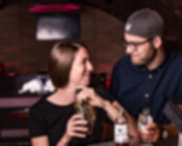 A young couple enjoying a Bärnstein cocktail in the bar.