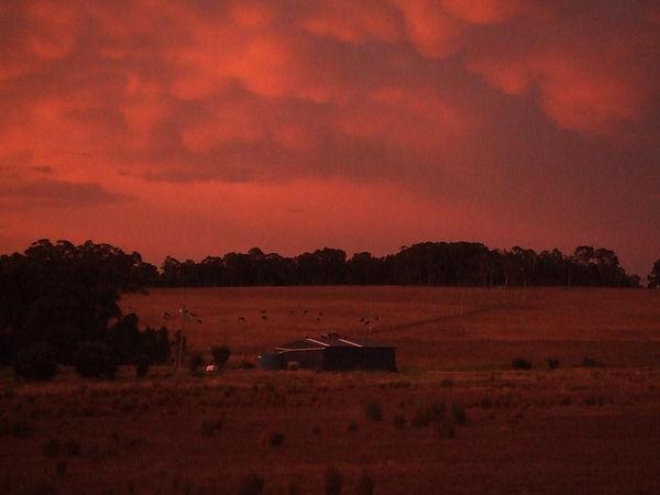 201003_storm sunset over vineyard shed.j