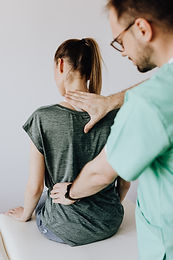 crop-osteopath-checking-up-back-of-anony