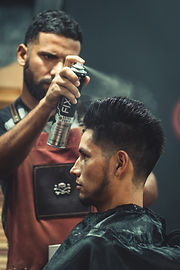 barber-using-hair-spray-2068672.jpg