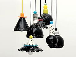 מנורות קרמיקה שחורות בצורות שונות ועיטורים שונים