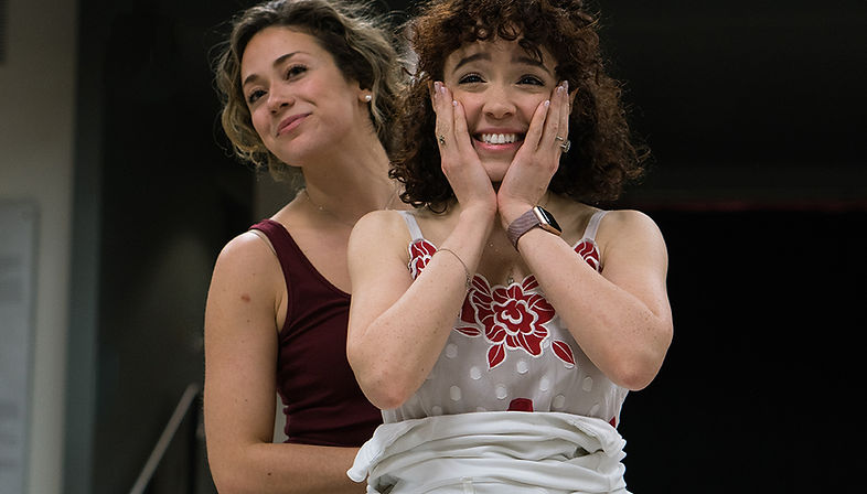 Rebbekah Vega-Romero as Maria and Danielle Marie Gonzalez as Anita, in rehearsal for West Side Story at the 5th Avenue Theatre.