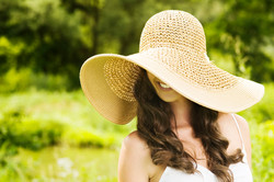 Young smiling woman in summer hat