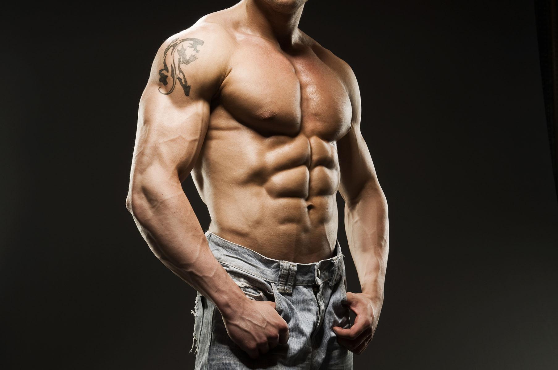 Muscular Male Torso in blue jeans
