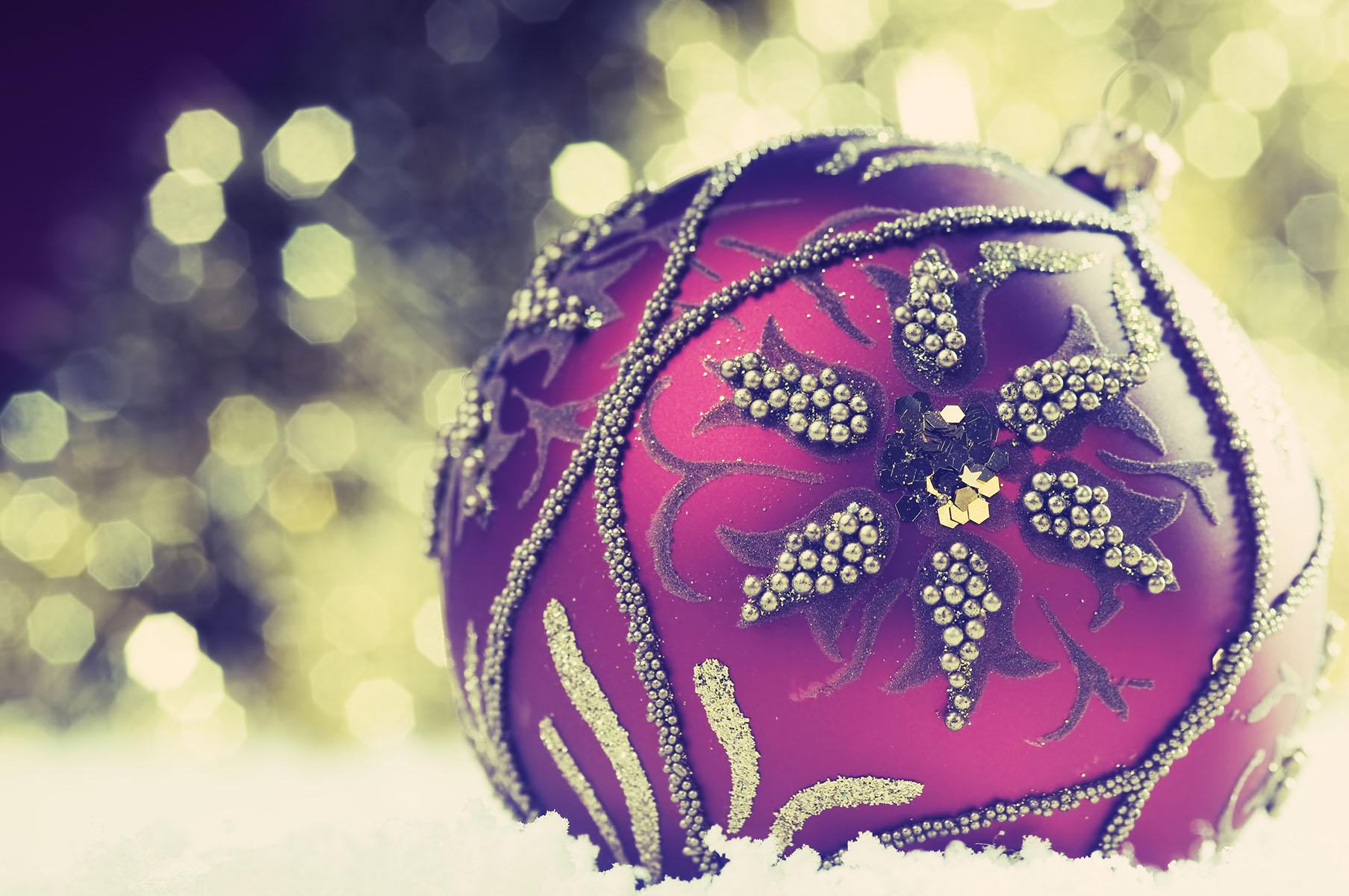 Christmas bauble on defocused lights