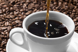 Pouring stream of brown coffee