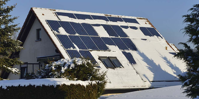 185_185-snow-on-solar-panels-on-house-12