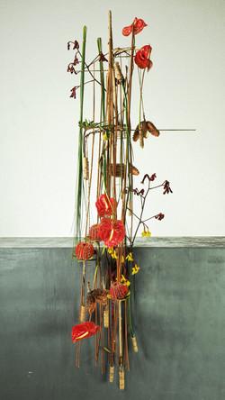 Overhanging floral design with anthuriums