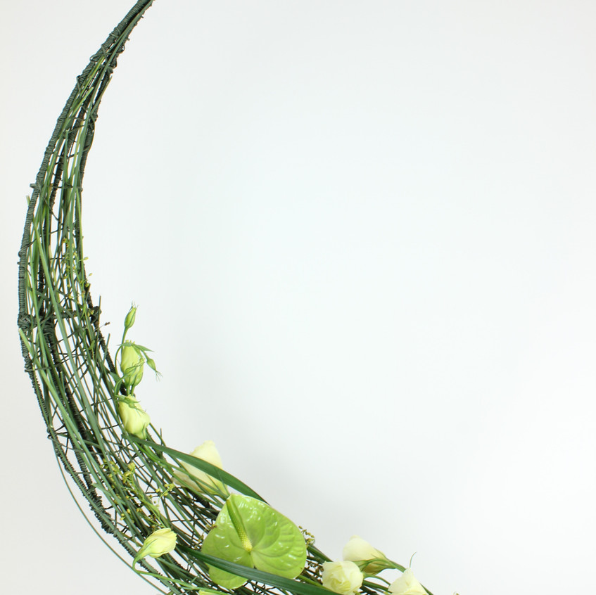 Hand Made structure for crescent floral design using fresh flowers including anthuriums and lisianthus