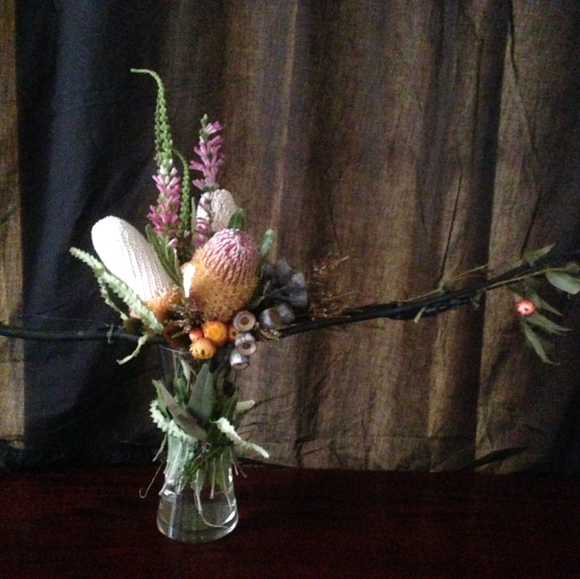 contemporary floral design with hand made frame structure of branches and Australian native fresh flowers