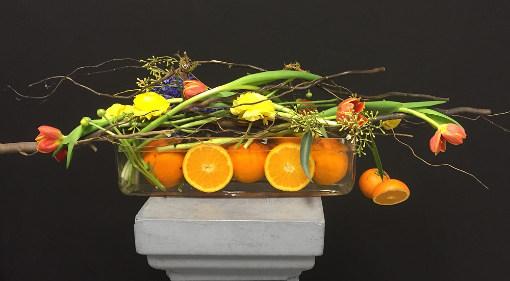 Soul Design Orange Fruit Floral Arrangement with tulips and Ranunculis