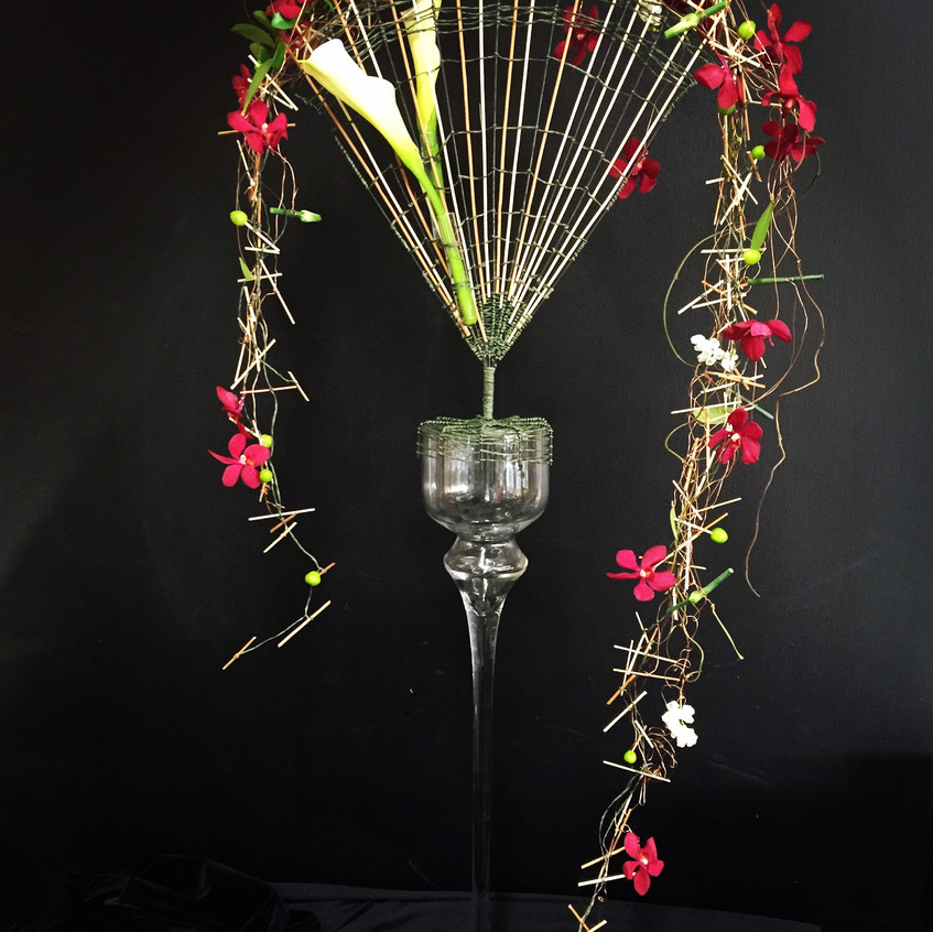 Floral design with hand made structure - fan design with garland of orchids and focal feature calla lilies