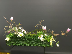 Magnolia floral design with pinned leaves