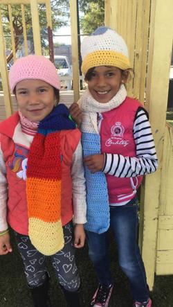 Sisters wearing hats given at fiesta