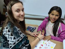 A team member with student Johana