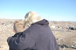 Grandma and grandson at the dump