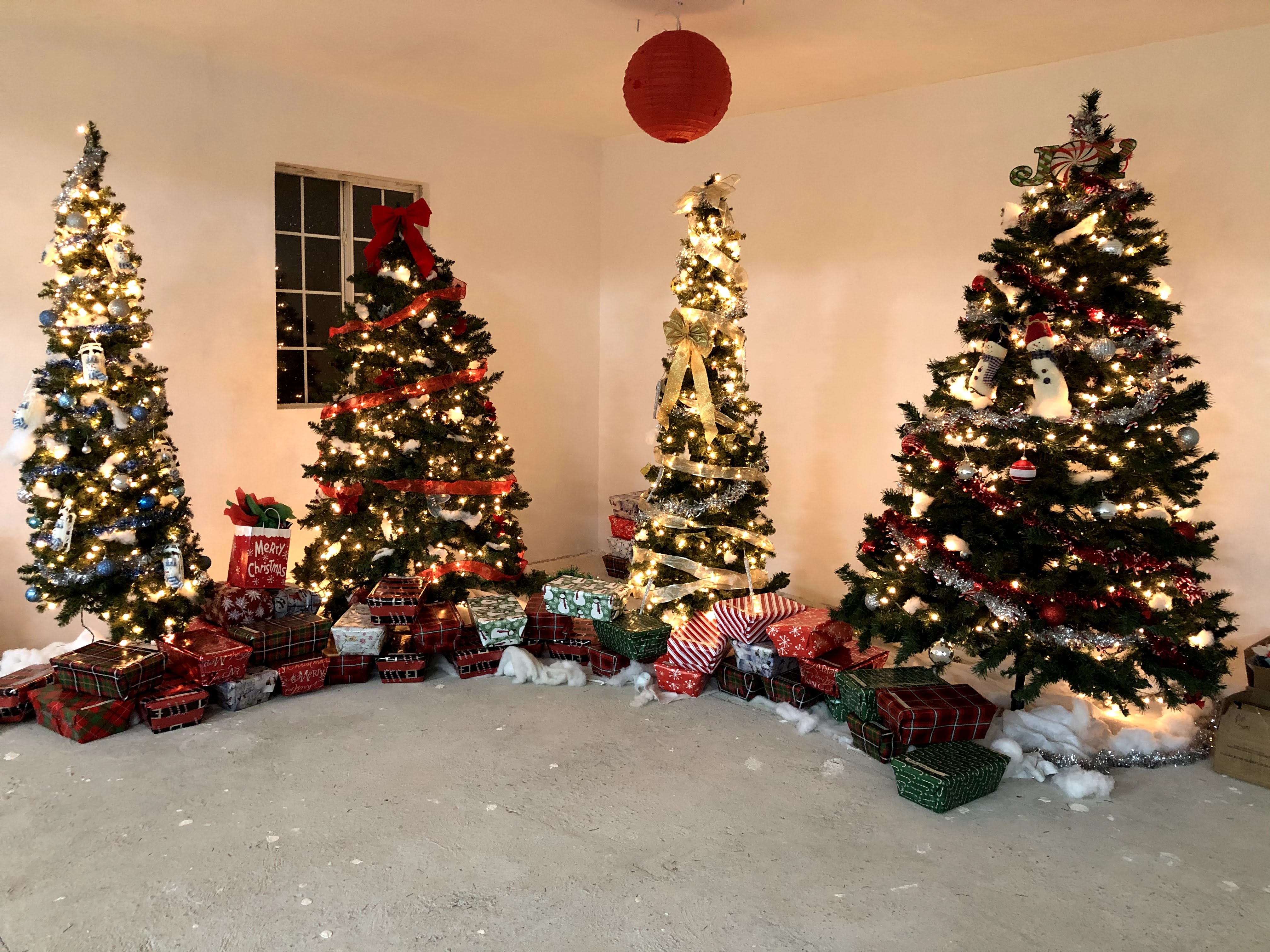 The Christmas trees with gifts