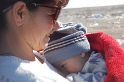 Rosa with a baby at the dump