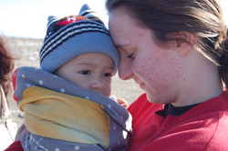 A team member with a baby at dump