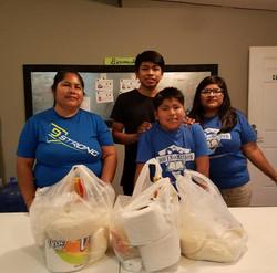 Staff member Jovita with brothers Uziel & Neri with their mom