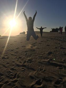 Team members climbed a sand