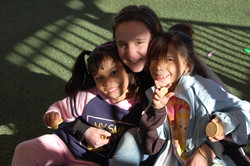 A team member with two students
