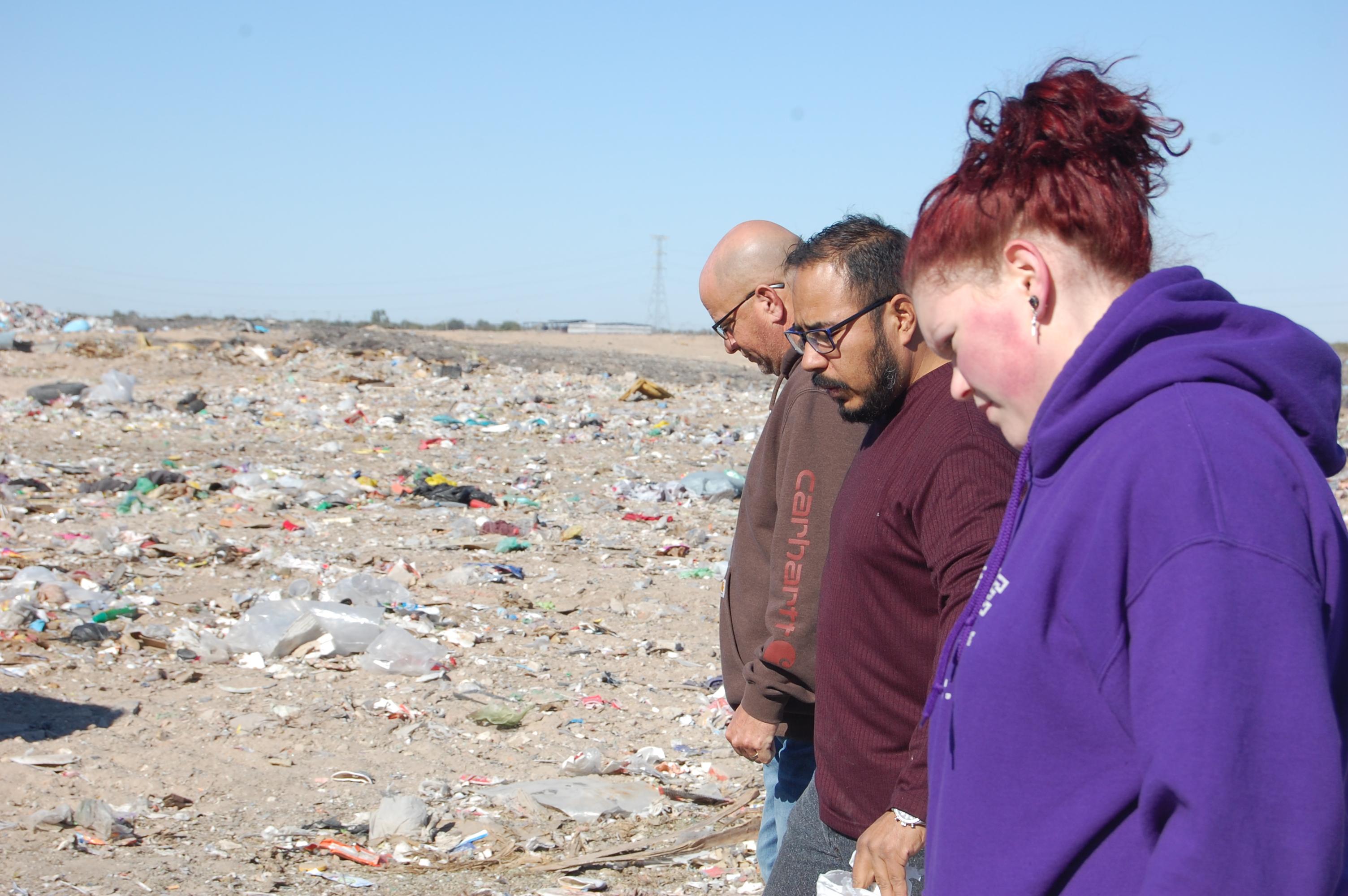 Praying at the dump