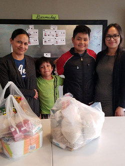 Uriel and Lemuel with their mom and sister