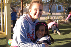 A team member with student Marlen