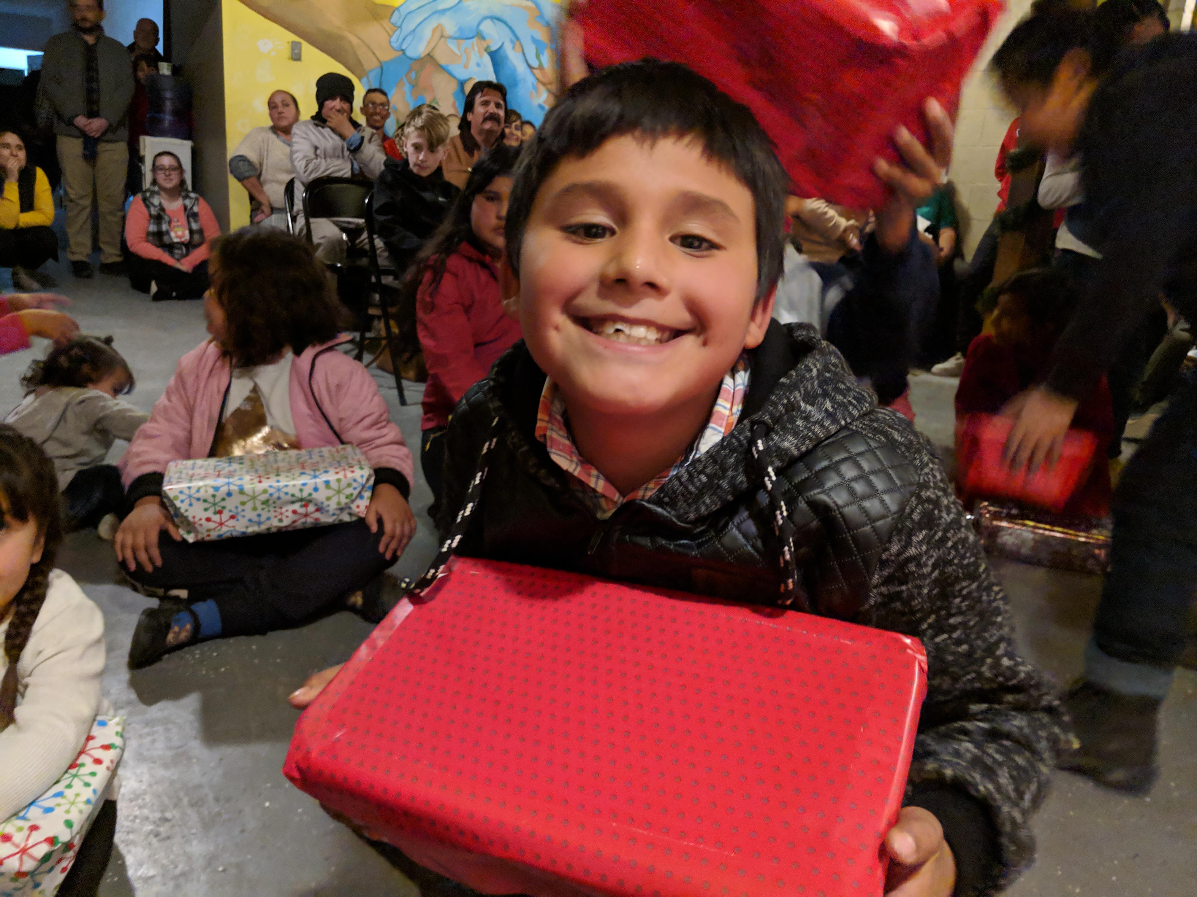 Student Brayan with Christmas gift
