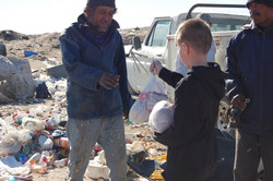 Handing food out at the dump