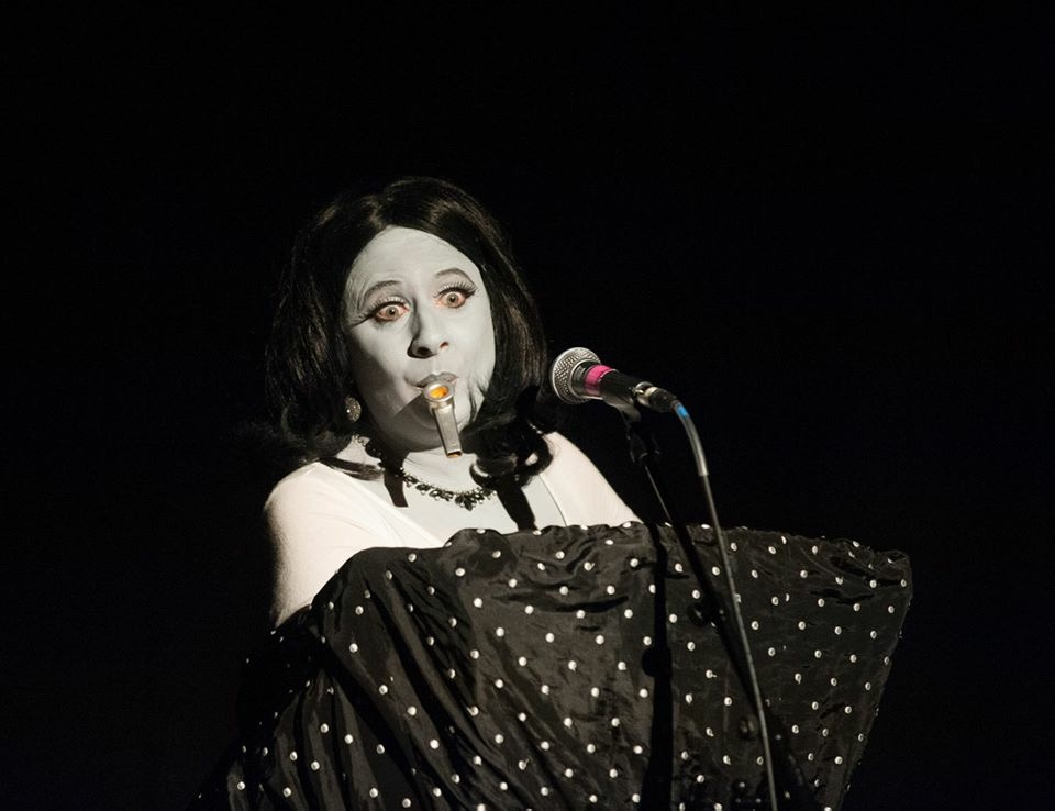 Claire Benjamin as Meg la Maniac
