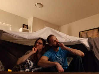 Pondering the vast mysteries of the universe in our blanket fort